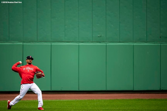 BOSTON, MA - OCTOBER 3: Mookie Betts #50 of the Boston Red Sox throws the ball during a workout before the American League Division Series on October 3, 2018 at Fenway Park in Boston, Massachusetts. (Photo by Billie Weiss/Boston Red Sox/Getty Images) *** Local Caption *** Mookie Betts