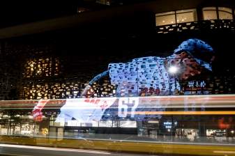October 3, 2018, Boston, MA: A projected image of Boston Red Sox shortstop Xander Bogaerts covers the Novartis building in Cambridge, Massachusetts Wednesday, October 3, 2018. (Photo by Reginald Thomas II/Boston Red Sox)