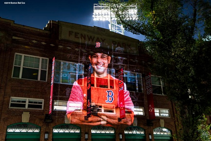 BOSTON, MA - OCTOBER 4: An image of manager Alex Cora of the Boston Red Sox is projected onto the Jersey Street facade at Fenway Park on October 4, 2018 in Boston, Massachusetts. (Photo by Billie Weiss/Boston Red Sox/Getty Images) *** Local Caption *** Alex Cora