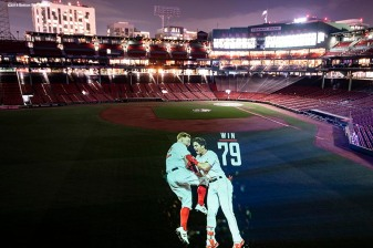 BOSTON, MA - OCTOBER 4: An image of Brock Holt #12 and Andrew Benintendi #16 of the Boston Red Sox is projected onto the field Fenway Park on October 4, 2018 in Boston, Massachusetts. (Photo by Billie Weiss/Boston Red Sox/Getty Images) *** Local Caption *** Brock Holt; Andrew Benintendi