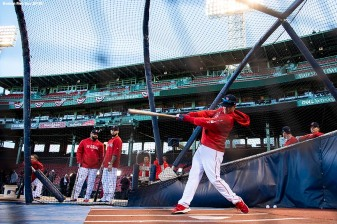BOSTON, MA - OCTOBER 5: Brock Holt #12 of the Boston Red Sox takes batting practice before game one of the American League Division Series against the New York Yankees on October 5, 2018 at Fenway Park in Boston, Massachusetts. (Photo by Billie Weiss/Boston Red Sox/Getty Images) *** Local Caption *** Brock Holt