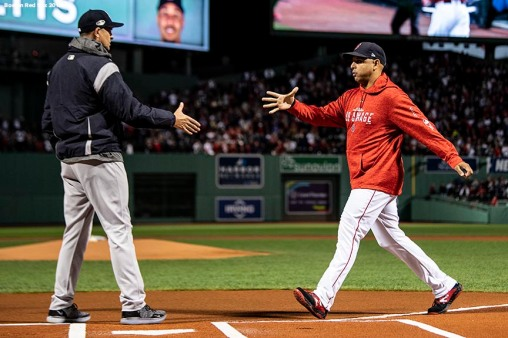 BOSTON, MA - OCTOBER 5: Manager Alex Cora of the Boston Red Sox shakes hands with Manager Aaron Boone of the New York Yankees before game one of the American League Division Series on October 5, 2018 at Fenway Park in Boston, Massachusetts. (Photo by Billie Weiss/Boston Red Sox/Getty Images) *** Local Caption *** Alex Cora; Aaron Boone