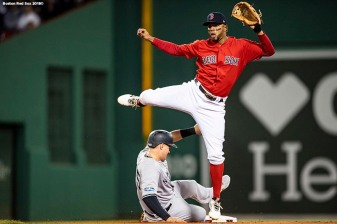 BOSTON, MA - OCTOBER 5: Xander Bogaerts #2 of the Boston Red Sox turns a double play over Luke Voit #45 of the New York Yankees during the second inning of game one of the American League Division Series on October 5, 2018 at Fenway Park in Boston, Massachusetts. (Photo by Billie Weiss/Boston Red Sox/Getty Images) *** Local Caption *** Luke Voit; Xander Bogaerts