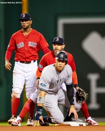 BOSTON, MA - OCTOBER 5: Aaron Judge #99 of the New York Yankees is tagged out by Xander Bogaerts #2 of the Boston Red Sox and Ian Kinsler #5 during the sixth inning of game one of the American League Division Series on October 5, 2018 at Fenway Park in Boston, Massachusetts. (Photo by Billie Weiss/Boston Red Sox/Getty Images) *** Local Caption *** Ian Kinsler; Xander Bogaerts; Aaron Judge
