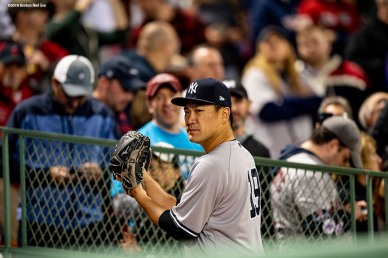BOSTON, MA - OCTOBER 6: Masahiro Tanaka #19 of the New York Yankees warms up before game two of the American League Division Series against the Boston Red Sox on October 6, 2018 at Fenway Park in Boston, Massachusetts. (Photo by Billie Weiss/Boston Red Sox/Getty Images) *** Local Caption *** Masahiro Tanaka