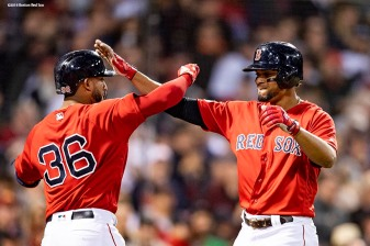 BOSTON, MA - OCTOBER 6: Xander Bogaerts #2 of the Boston Red Sox reacts with Eduardo Nunez #36 after hitting a solo home run during the fourth inning of game two of the American League Division Series against the New York Yankees on October 6, 2018 at Fenway Park in Boston, Massachusetts. (Photo by Billie Weiss/Boston Red Sox/Getty Images) *** Local Caption *** Xander Bogaerts; Eduardo Nunez