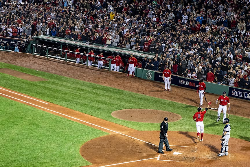 BOSTON, MA - OCTOBER 6: Xander Bogaerts #2 of the Boston Red Sox reacts after hitting a solo home run during the fourth inning of game two of the American League Division Series against the New York Yankees on October 6, 2018 at Fenway Park in Boston, Massachusetts. (Photo by Billie Weiss/Boston Red Sox/Getty Images) *** Local Caption *** Xander Bogaerts