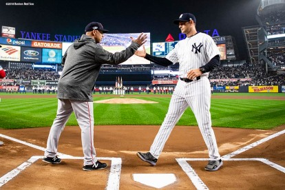 NEW YORK, NY - OCTOBER 8: Manager Alex Cora of the Boston Red Sox shakes hands with Manager Aaron Boone of the New York Yankees before game three of the American League Division Series on October 8, 2018 at Yankee Stadium in the Bronx borough of New York City. (Photo by Billie Weiss/Boston Red Sox/Getty Images) *** Local Caption *** Alex Cora; Aaron Boone