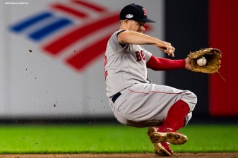 NEW YORK, NY - OCTOBER 8: Brock Holt #12 of the Boston Red Sox fields a ground ball during the third inning of game three of the American League Division Series against the New York Yankees on October 8, 2018 at Yankee Stadium in the Bronx borough of New York City. (Photo by Billie Weiss/Boston Red Sox/Getty Images) *** Local Caption *** Brock Holt
