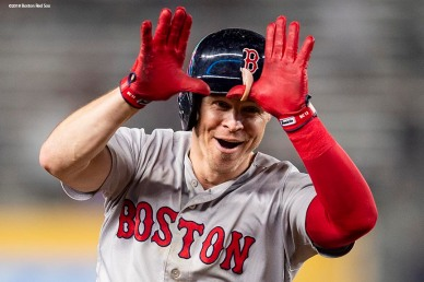 NEW YORK, NY - OCTOBER 8: Brock Holt #12 of the Boston Red Sox reacts after hitting a home run during the inning of game three of the American League Division Series to hit for the cycle against the New York Yankees on October 8, 2018 at Yankee Stadium in the Bronx borough of New York City. (Photo by Billie Weiss/Boston Red Sox/Getty Images) *** Local Caption *** Brock Holt