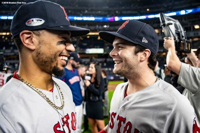 NEW YORK, NY - OCTOBER 9: Mookie Betts #50 and Andrew Benintendi #16 of the Boston Red Sox celebrate after clinching the American League Division Series in game four against the New York Yankees on October 9, 2018 at Yankee Stadium in the Bronx borough of New York City. (Photo by Billie Weiss/Boston Red Sox/Getty Images) *** Local Caption *** Mookie Betts; Andrew Benintendi