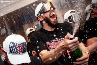 NEW YORK, NY - OCTOBER 9: Matt Barnes #32 of the Boston Red Sox celebrates with champagne in the clubhouse after clinching the American League Division Series in game four against the New York Yankees on October 9, 2018 at Yankee Stadium in the Bronx borough of New York City. (Photo by Billie Weiss/Boston Red Sox/Getty Images) *** Local Caption *** Matt Barnes