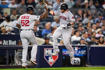 NEW YORK, NY - OCTOBER 9: Christian Vazquez #7 of the Boston Red Sox reacts with Carlos Febles #52 after hitting a solo home run during the fourth inning of game four of the American League Division Series against the New York Yankees on October 9, 2018 at Yankee Stadium in the Bronx borough of New York City. (Photo by Billie Weiss/Boston Red Sox/Getty Images) *** Local Caption *** Christian Vazquez; Carlos Febles