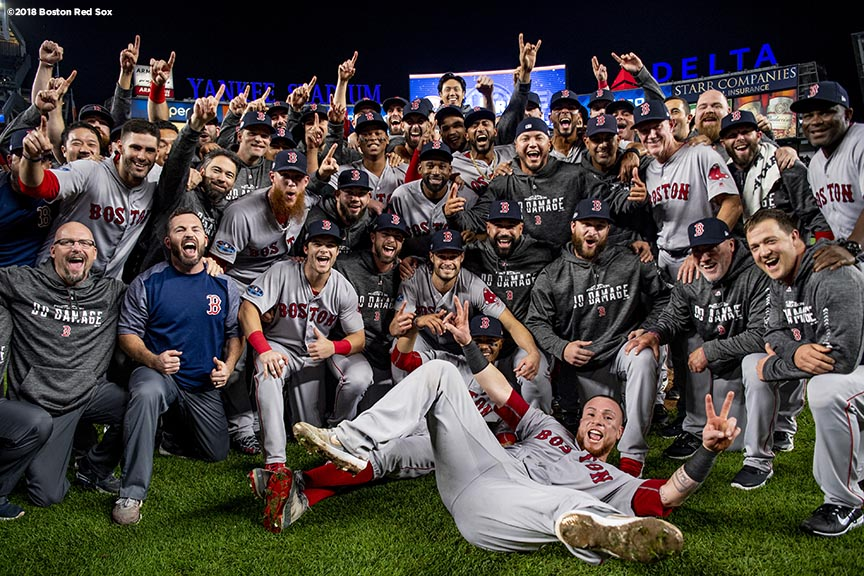 NEW YORK, NY - OCTOBER 9: Members of the Boston Red Sox pose for a team photograph after clinching the American League Division Series in game four against the New York Yankees on October 9, 2018 at Yankee Stadium in the Bronx borough of New York City. (Photo by Billie Weiss/Boston Red Sox/Getty Images) *** Local Caption ***