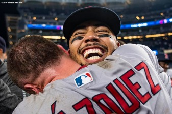 NEW YORK, NY - OCTOBER 9: Mookie Betts #50 and Christian Vazquez #7 of the Boston Red Sox celebrate after clinching the American League Division Series in game four against the New York Yankees on October 9, 2018 at Yankee Stadium in the Bronx borough of New York City. (Photo by Billie Weiss/Boston Red Sox/Getty Images) *** Local Caption *** Mookie Betts; Christian Vazquez