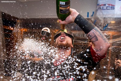 NEW YORK, NY - OCTOBER 9: Christian Vazquez #7 of the Boston Red Sox celebrates with champagne in the clubhouse after clinching the American League Division Series in game four against the New York Yankees on October 9, 2018 at Yankee Stadium in the Bronx borough of New York City. (Photo by Billie Weiss/Boston Red Sox/Getty Images) *** Local Caption *** Christian Vazquez
