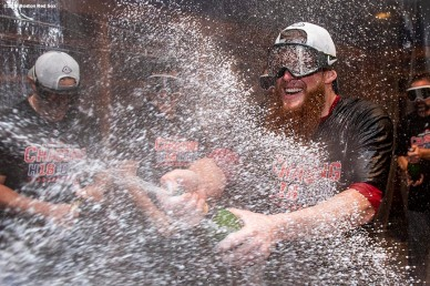 NEW YORK, NY - OCTOBER 9: Craig Kimbrel #46 of the Boston Red Sox celebrates with champagne in the clubhouse after clinching the American League Division Series in game four against the New York Yankees on October 9, 2018 at Yankee Stadium in the Bronx borough of New York City. (Photo by Billie Weiss/Boston Red Sox/Getty Images) *** Local Caption *** Craig Kimbrel