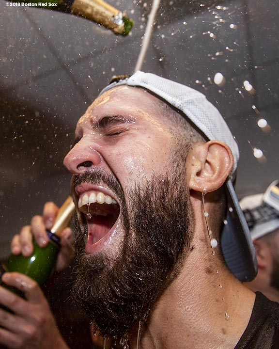 NEW YORK, NY - OCTOBER 9: Rick Porcello #22 of the Boston Red Sox celebrates with champagne in the clubhouse after clinching the American League Division Series in game four against the New York Yankees on October 9, 2018 at Yankee Stadium in the Bronx borough of New York City. (Photo by Billie Weiss/Boston Red Sox/Getty Images) *** Local Caption *** Rick Porcello
