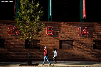 BOSTON, MA - OCTOBER 13: Fans walk past Fenway Park before game one of the American League Championship Series between the Boston Red Sox the Houston Astros on October 13, 2018 at Fenway Park in Boston, Massachusetts. (Photo by Billie Weiss/Boston Red Sox/Getty Images) *** Local Caption ***
