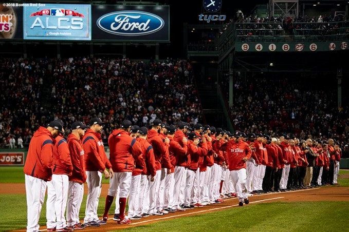 BOSTON, MA - OCTOBER 13: Manager Alex Cora of the Boston Red Sox high fives teammates as he is introduced before game one of the American League Championship Series against the Houston Astros on October 13, 2018 at Fenway Park in Boston, Massachusetts. (Photo by Billie Weiss/Boston Red Sox/Getty Images) *** Local Caption *** Alex Cora