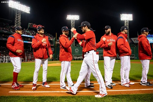 BOSTON, MA - OCTOBER 13: Andrew Benintendi #16 of the Boston Red Sox high fives teammates as he is introduced before game one of the American League Championship Series against the Houston Astros on October 13, 2018 at Fenway Park in Boston, Massachusetts. (Photo by Billie Weiss/Boston Red Sox/Getty Images) *** Local Caption *** Andrew Benintendi