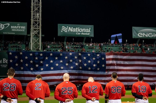 BOSTON, MA - OCTOBER 13: The American flag is dropped over the Green Monster as members of the Boston Red Sox look on before game one of the American League Championship Series against the Houston Astros on October 13, 2018 at Fenway Park in Boston, Massachusetts. (Photo by Billie Weiss/Boston Red Sox/Getty Images) *** Local Caption ***