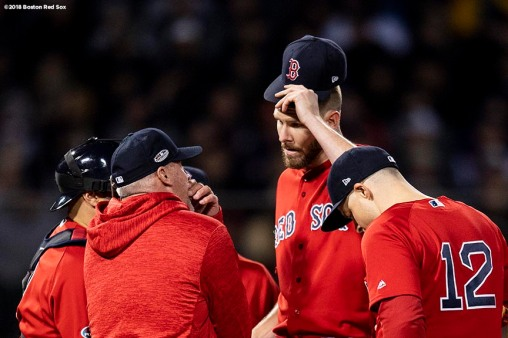 BOSTON, MA - OCTOBER 13: Chris Sale #41 of the Boston Red Sox reacts with pitching coach Dana Levangie during the second inning of game one of the American League Championship Series against the Houston Astros on October 13, 2018 at Fenway Park in Boston, Massachusetts. (Photo by Billie Weiss/Boston Red Sox/Getty Images) *** Local Caption *** Chris Sale; Dana Levangie