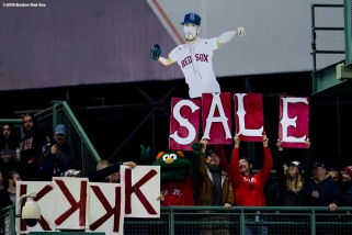 BOSTON, MA - OCTOBER 13: Fans hold up signs as Chris Sale #41 of the Boston Red Sox records a striekout during the fourth inning of game one of the American League Championship Series against the Houston Astros on October 13, 2018 at Fenway Park in Boston, Massachusetts. (Photo by Billie Weiss/Boston Red Sox/Getty Images) *** Local Caption *** Chris Sale