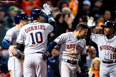 BOSTON, MA - OCTOBER 13: Yuli Gurriel #10 of the Houston Astros reacts with Alex Bregman #10, Jose Altuve #27, and Tony Kemp #18 after hitting a three run home run during the ninth inning of game one of the American League Championship Series against the Boston Red Sox on October 13, 2018 at Fenway Park in Boston, Massachusetts. (Photo by Billie Weiss/Boston Red Sox/Getty Images) *** Local Caption *** Yuli Gurriel; Alex Bregman; Jose Altuve; Tony Kemp