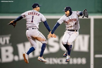 BOSTON, MA - OCTOBER 13: Carlos Correa #1 and George Springer #4 of the Houston Astros celebrate a victory in game one of the American League Championship Series against the Boston Red Sox on October 13, 2018 at Fenway Park in Boston, Massachusetts. (Photo by Billie Weiss/Boston Red Sox/Getty Images) *** Local Caption *** Carlos Correa; George Springer