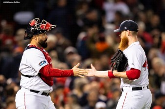 BOSTON, MA - OCTOBER 14: Craig Kimbrel #46 high fives Sandy Leon #3 of the Boston Red Sox after a victory in game two of the American League Championship Series against the Houston Astros on October 14, 2018 at Fenway Park in Boston, Massachusetts. (Photo by Billie Weiss/Boston Red Sox/Getty Images) *** Local Caption *** Craig Kimbrel; Sandy Leon