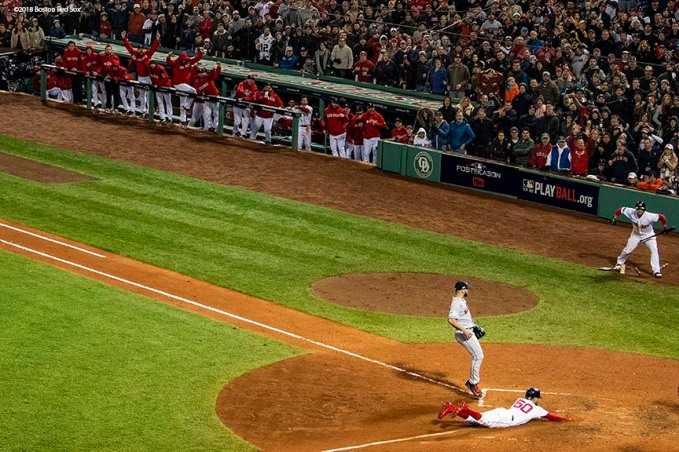 BOSTON, MA - OCTOBER 14: Mookie Betts #50 of the Boston Red Sox slides into home plate to score on a passed ball by Lance McCullers Jr. #43 of the Houston Astros during the seventh inning of game two of the American League Championship Series on October 14, 2018 at Fenway Park in Boston, Massachusetts. (Photo by Billie Weiss/Boston Red Sox/Getty Images) *** Local Caption *** Mookie Betts; Lance McCullers Jr.