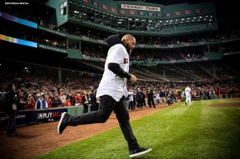 BOSTON, MA - OCTOBER 14: Former Boston Red Sox player Jonny Gomes runs to the mound before throwing out a ceremonial first pitch before game two of the American League Championship Series against the Houston Astros on October 14, 2018 at Fenway Park in Boston, Massachusetts. (Photo by Billie Weiss/Boston Red Sox/Getty Images) *** Local Caption *** Jonny Gomes