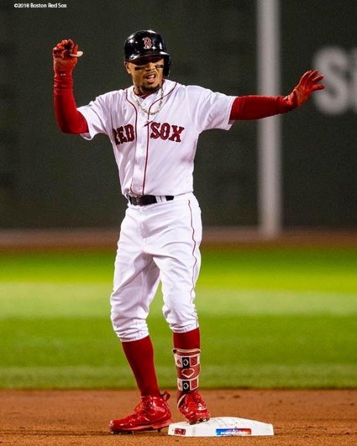 BOSTON, MA - OCTOBER 14: Mookie Betts #50 of the Boston Red Sox reacts after hitting a double during the first inning of game two of the American League Championship Series against the Houston Astros on October 14, 2018 at Fenway Park in Boston, Massachusetts. (Photo by Billie Weiss/Boston Red Sox/Getty Images) *** Local Caption *** Mookie Betts