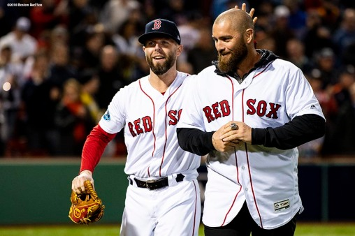 BOSTON, MA - OCTOBER 14: Former Boston Red Sox player Jonny Gomes reacts with Dustin Pedroia #15 after throwing out a ceremonial first pitch before game two of the American League Championship Series against the Houston Astros on October 14, 2018 at Fenway Park in Boston, Massachusetts. (Photo by Billie Weiss/Boston Red Sox/Getty Images) *** Local Caption *** Jonny Gomes; Dustin Pedroia
