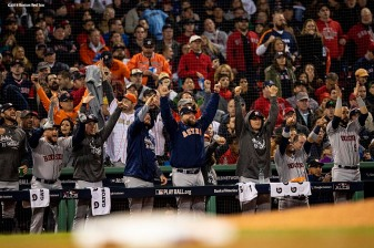 BOSTON, MA - OCTOBER 14: Members of the Houston Astros react during the second inning of game two of the American League Championship Series against the Houston Astros on October 14, 2018 at Fenway Park in Boston, Massachusetts. (Photo by Billie Weiss/Boston Red Sox/Getty Images) *** Local Caption ***