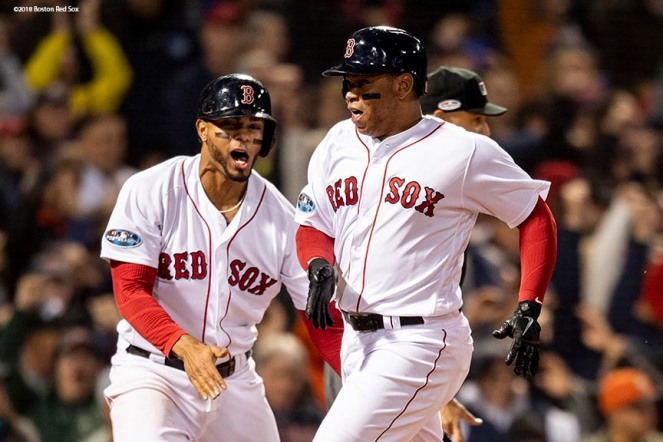 BOSTON, MA - OCTOBER 14: Rafael Devers #11 reacts with Xander Bogaerts #2 of the Boston Red Sox as he scores during the third inning of game two of the American League Championship Series against the Houston Astros on October 14, 2018 at Fenway Park in Boston, Massachusetts. (Photo by Billie Weiss/Boston Red Sox/Getty Images) *** Local Caption *** Rafael Devers; Xander Bogaerts