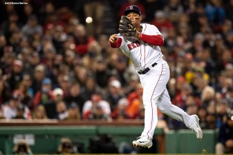 BOSTON, MA - OCTOBER 14: Rafael Devers #11 of the Boston Red Sox throws to first base during the fifth inning of game two of the American League Championship Series against the Houston Astros on October 14, 2018 at Fenway Park in Boston, Massachusetts. (Photo by Billie Weiss/Boston Red Sox/Getty Images) *** Local Caption *** Rafael Devers