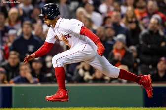 BOSTON, MA - OCTOBER 14: Mookie Betts #50 of the Boston Red Sox runs toward home plate to score on a passed ball during the seventh inning of game two of the American League Championship Series against the Houston Astros on October 14, 2018 at Fenway Park in Boston, Massachusetts. (Photo by Billie Weiss/Boston Red Sox/Getty Images) *** Local Caption *** Mookie Betts