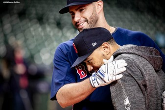HOUSTON, TX - OCTOBER 15: J.D. Martinez #28 hugs Mookie Betts #50 of the Boston Red Sox during a workout before game three of the American League Championship Series against the Houston Astros on October 15, 2018 at Minute Maid Park in Houston, Texas. (Photo by Billie Weiss/Boston Red Sox/Getty Images) *** Local Caption *** J.D. Martinez; Mookie Betts