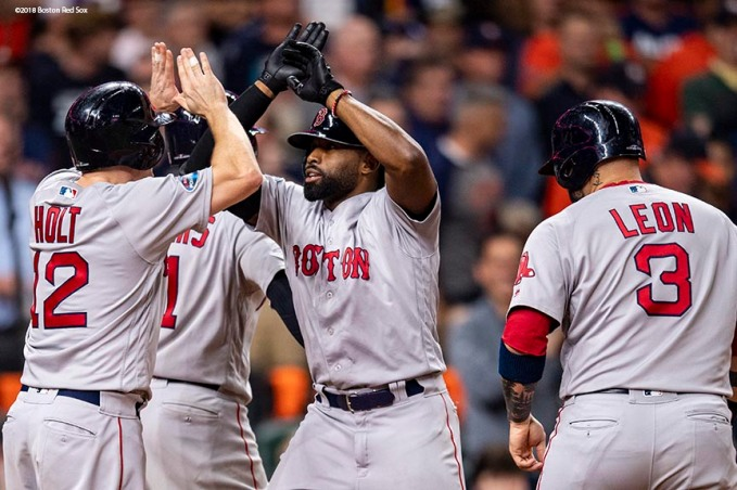 HOUSTON, TX - OCTOBER 16: Jackie Bradley Jr. #19 of the Boston Red Sox reacts with Rafael Devers #11, Brock Holt #12, and Sandy Leon #3 after hitting a grand slam home run during the eighth inning of game three of the American League Championship Series against the Houston Astros on October 16, 2018 at Minute Maid Park in Houston, Texas. (Photo by Billie Weiss/Boston Red Sox/Getty Images) *** Local Caption *** Jackie Bradley Jr.; Sandy Leon; Brock Holt; Rafael Devers
