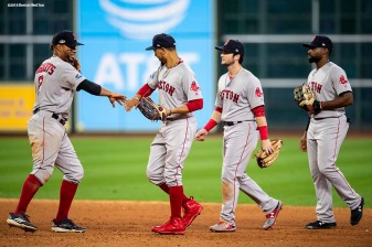 HOUSTON, TX - OCTOBER 16: Xander Bogaerts #2, Andrew Benintendi #16, Jackie Bradley Jr. #19, and Mookie Betts #50 of the Boston Red Sox celebrate a victory in game three of the American League Championship Series against the Houston Astros on October 16, 2018 at Minute Maid Park in Houston, Texas. (Photo by Billie Weiss/Boston Red Sox/Getty Images) *** Local Caption *** Andrew Benintendi; Mookie Betts; Jackie Bradley Jr.; Xander Bogaerts