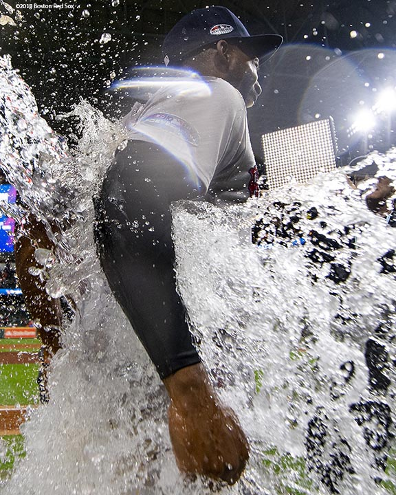 HOUSTON, TX - OCTOBER 16: Jackie Bradley Jr. #19 of the Boston Red Sox is doused with Gatorade after a victory in game three of the American League Championship Series against the Houston Astros on October 16, 2018 at Minute Maid Park in Houston, Texas. (Photo by Billie Weiss/Boston Red Sox/Getty Images) *** Local Caption *** Jackie Bradley Jr.