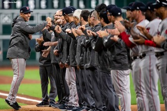HOUSTON, TX - OCTOBER 16: Manager Alex Cora of the Boston Red Sox high fives teammates as he is introduced before game three of the American League Championship Series against the Houston Astros on October 16, 2018 at Minute Maid Park in Houston, Texas. (Photo by Billie Weiss/Boston Red Sox/Getty Images) *** Local Caption *** Alex Cora