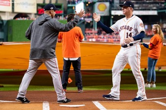 HOUSTON, TX - OCTOBER 16: Manager Alex Cora of the Boston Red Sox shakes hands with manager A.J. Hinch of the Houston Astros as lineups are introduced before game three of the American League Championship Series on October 16, 2018 at Minute Maid Park in Houston, Texas. (Photo by Billie Weiss/Boston Red Sox/Getty Images) *** Local Caption *** Alex Cora; A.J. Hinch