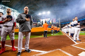 HOUSTON, TX - OCTOBER 16: Manager Alex Cora of the Boston Red Sox looks on alongside manager A.J. Hinch of the Houston Astros as lineups are introduced before game three of the American League Championship Series on October 16, 2018 at Minute Maid Park in Houston, Texas. (Photo by Billie Weiss/Boston Red Sox/Getty Images) *** Local Caption *** Alex Cora; A.J. Hinch