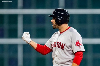 HOUSTON, TX - OCTOBER 16: J.D. Martinez #28 of the Boston Red Sox reacts after hitting an RBI double during the first inning of game three of the American League Championship Series against the Houston Astros on October 16, 2018 at Minute Maid Park in Houston, Texas. (Photo by Billie Weiss/Boston Red Sox/Getty Images) *** Local Caption *** J.D. Martinez