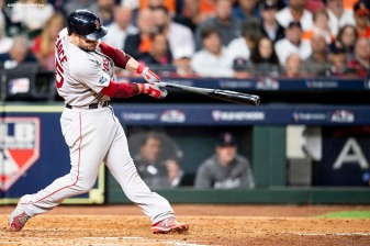 HOUSTON, TX - OCTOBER 16: Steve Pearce #25 of the Boston Red Sox hits a solo home run during the sixth inning of game three of the American League Championship Series against the Houston Astros on October 16, 2018 at Minute Maid Park in Houston, Texas. (Photo by Billie Weiss/Boston Red Sox/Getty Images) *** Local Caption *** Steve Pearce