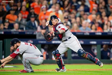 HOUSTON, TX - OCTOBER 16: Christian Vazquez #7 prepares to throw to first base as Ryan Brasier #70 of the Boston Red Sox ducks away during the seventh inning of game three of the American League Championship Series against the Houston Astros on October 16, 2018 at Minute Maid Park in Houston, Texas. (Photo by Billie Weiss/Boston Red Sox/Getty Images) *** Local Caption *** Christian Vazquez; Ryan Brasier