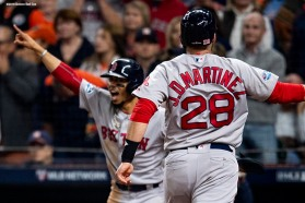 HOUSTON, TX - OCTOBER 17: Mookie Betts #50 and J.D. Martinez #28 of the Boston Red Sox react as they score during the first inning of game four of the American League Championship Series against the Houston Astros on October 17, 2018 at Minute Maid Park in Houston, Texas. (Photo by Billie Weiss/Boston Red Sox/Getty Images) *** Local Caption *** Mookie Betts; J.D. Martinez
